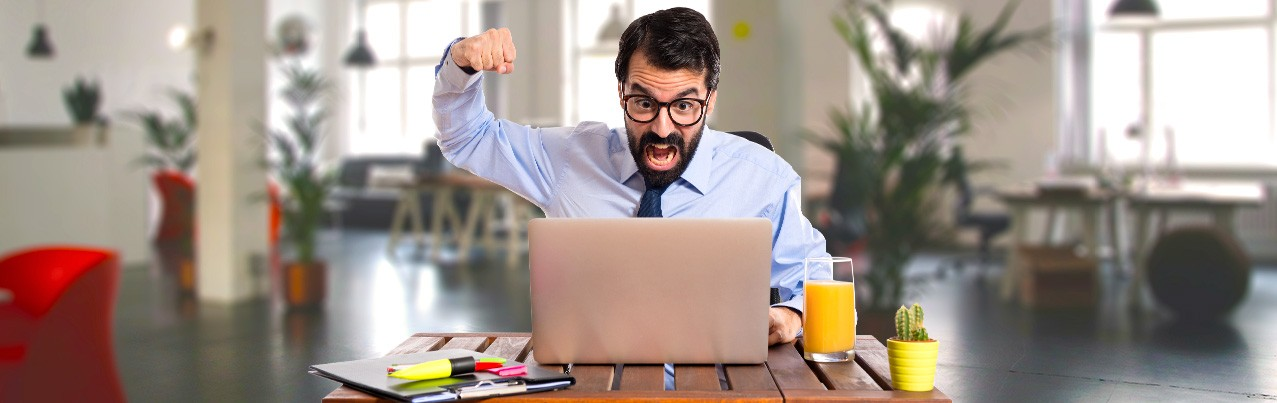angry man raised fist to his laptop