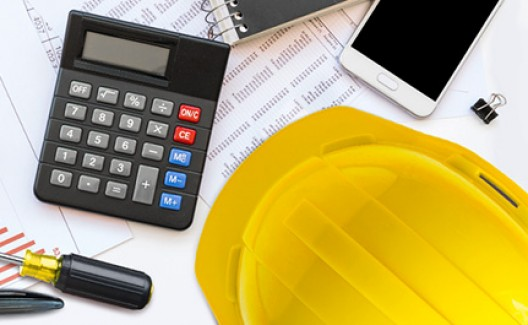 yellow hard hat with calculator