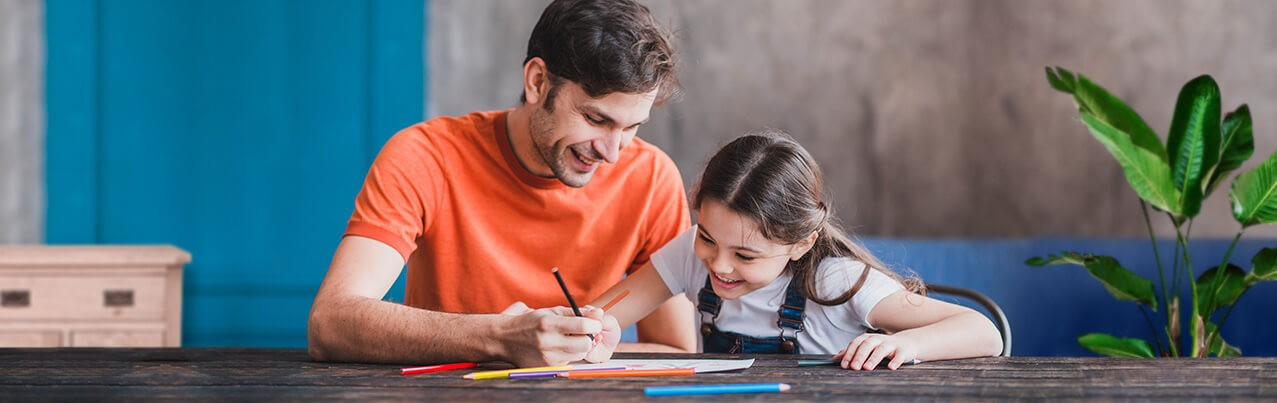 father and daughter doing art activity