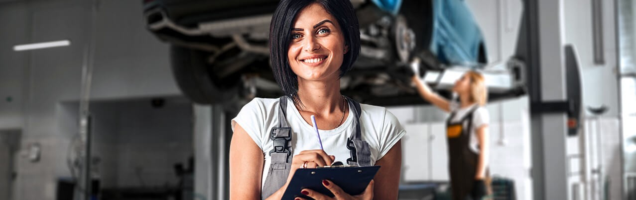 car repair woman with checklist