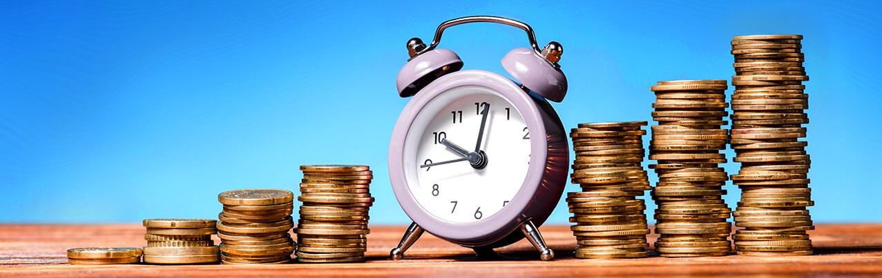 alarm clock with stack of coins