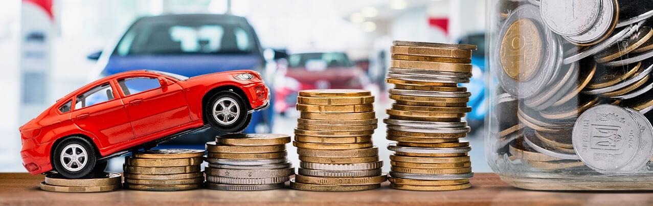 red car climbing coin stacks