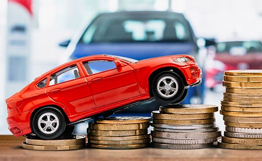 red car climbing coin stacks