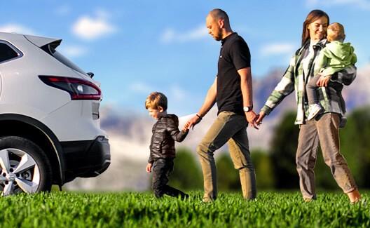 family walking towards car